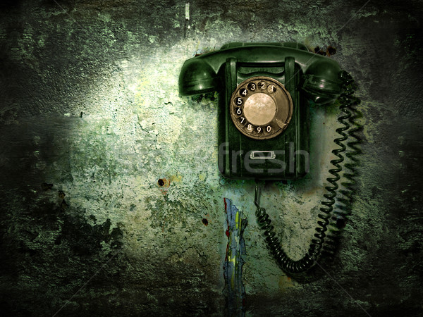 Stock photo: Old phone on the destroyed wall