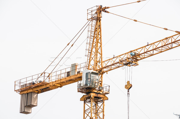Cab lifting crane in the construction site. Stock photo © zeffss