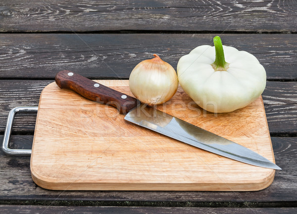 Onions, squash and knife on board Stock photo © zeffss