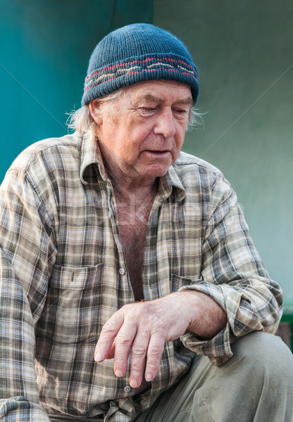 Seniors portrait of contemplative old caucasian man looking down Stock photo © zeffss