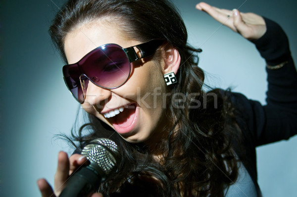 Girl Singing Stock photo © zeffss
