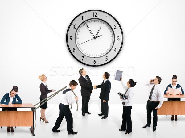 équipe commerciale femme mur horloge travaux affaires Photo stock © zeffss