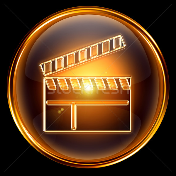 movie clapper board icon golden, isolated on black background. Stock photo © zeffss