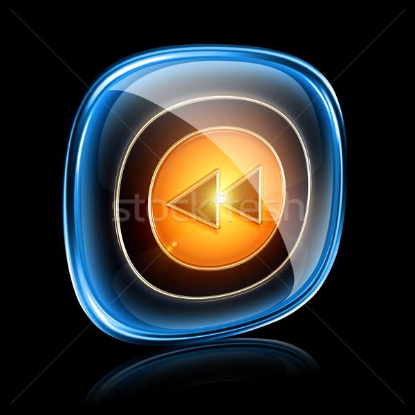 Rewind Back icon neon, isolated on black background Stock photo © zeffss