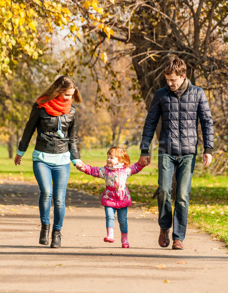 Stock photo: Happy young family walks in the park