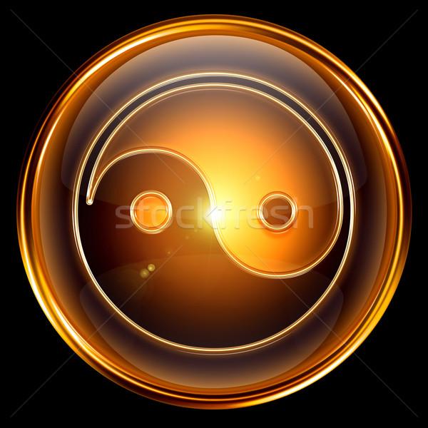 yin yang symbol icon golden, isolated on black background. Stock photo © zeffss
