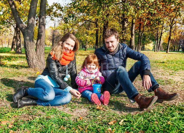 Happy young family in an autumn park Stock photo © zeffss