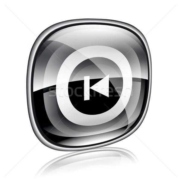Rewind Back icon black glass, isolated on white background. Stock photo © zeffss