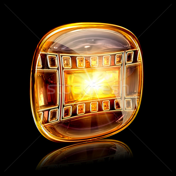 film icon amber, isolated on black background Stock photo © zeffss