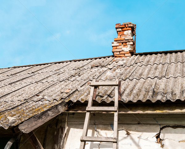 Old rustic roof on the old building Stock photo © zeffss