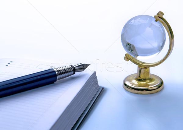 Notebook pen mondo ufficio libro vetro Foto d'archivio © zeffss