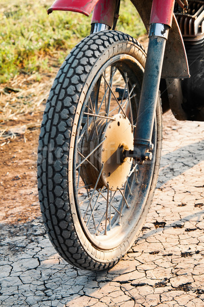 Old wheel motorcycle on a dirt road.  Stock photo © zeffss