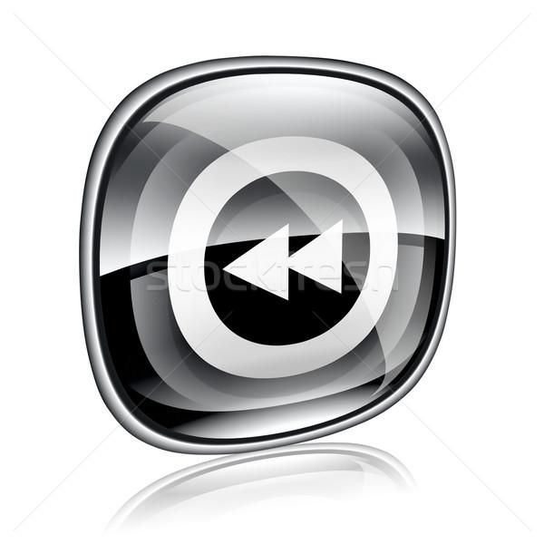 Rewind icon black glass, isolated on white background. Stock photo © zeffss