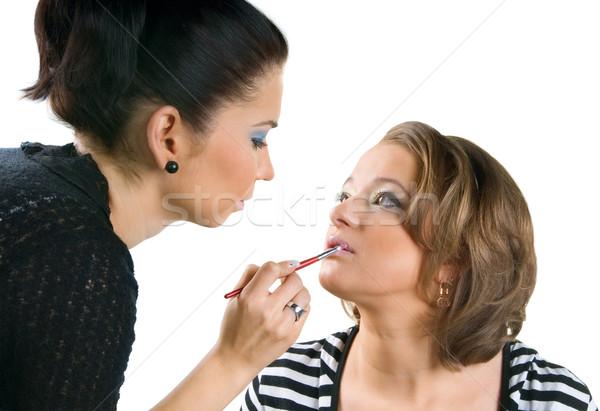 Makeup artist applying lipstick using lip concealer brush Stock photo © zeffss