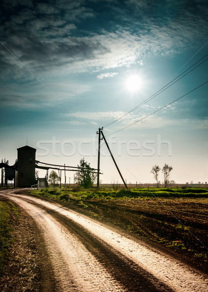 Zon wolken veld weg fantastisch landschap Stockfoto © zeffss
