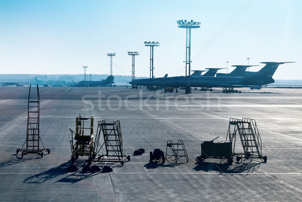 Airplane is being serviced by the ground crew.  Stock photo © zeffss
