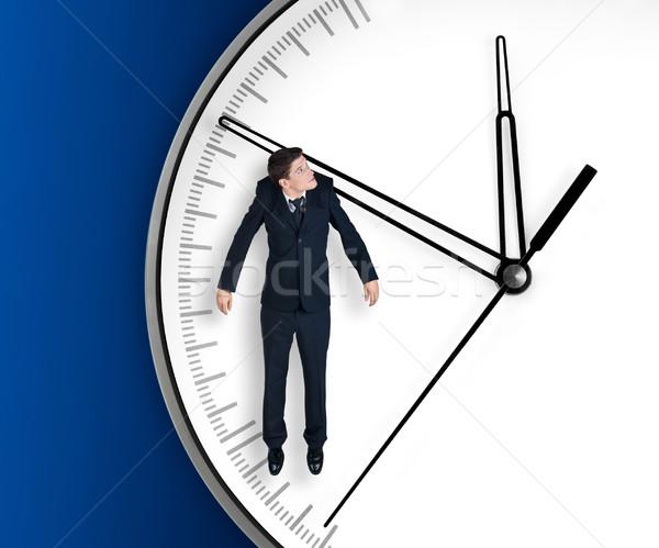 Empresário seta relógio isolado azul trabalhar Foto stock © zeffss
