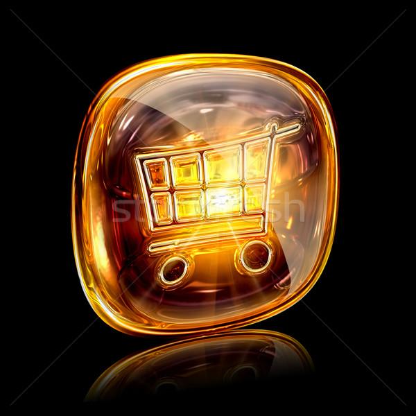 shopping cart icon amber, isolated on black background Stock photo © zeffss