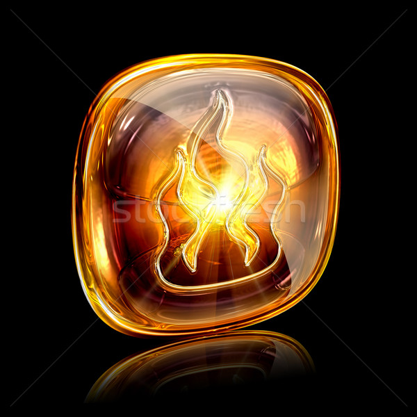 fire icon amber, isolated on black background Stock photo © zeffss