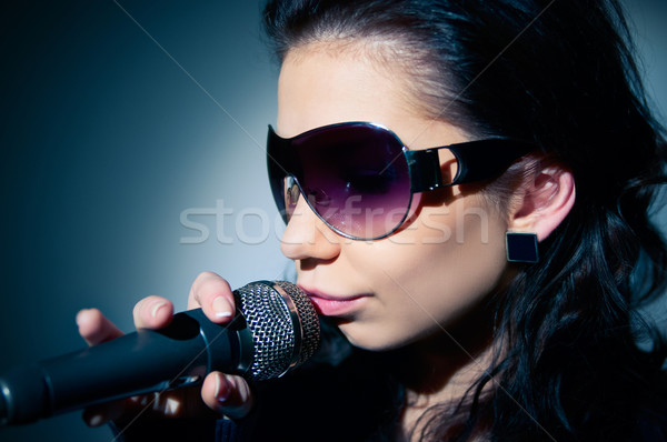 Girl Singing Stock photo © zeffss