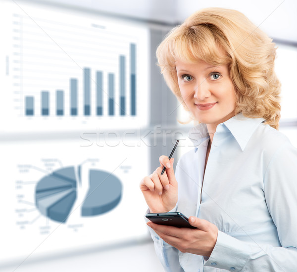 Zakenvrouw smartphone graphics charts computer gelukkig Stockfoto © zeffss
