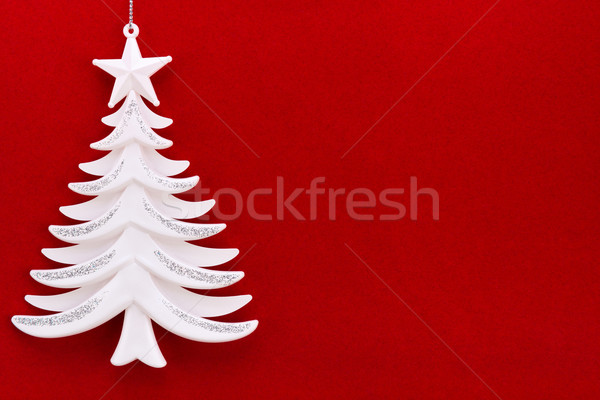 Christmas tree on a background of red velvet paper Stock photo © zeffss