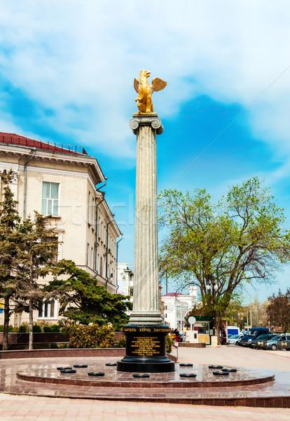 Griffin sculpture on a pedestal Stock photo © zeffss
