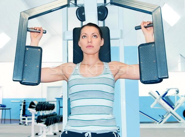 Woman in fitness club Stock photo © zeffss