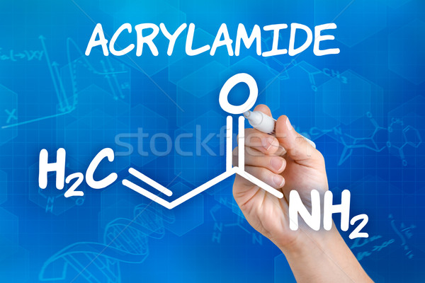 Hand with pen drawing the chemical formula of acrylamide Stock photo © Zerbor