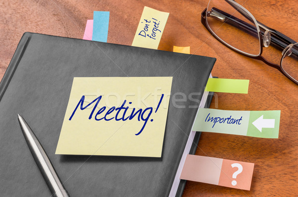 Planner with sticky note - Meeting Stock photo © Zerbor