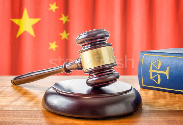 A gavel and a law book - China Stock photo © Zerbor