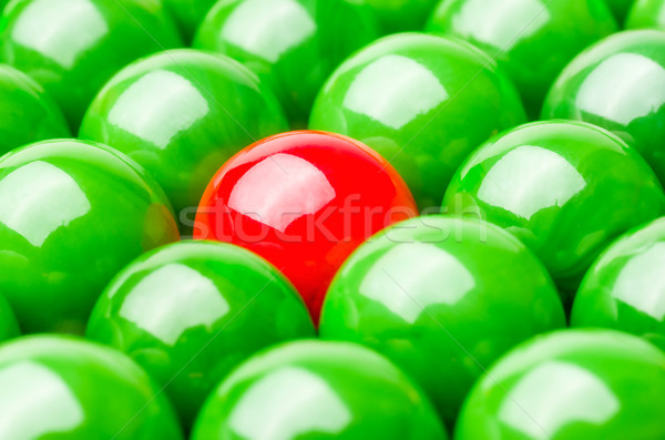 Concept with red and green marbles -  Being different Stock photo © Zerbor