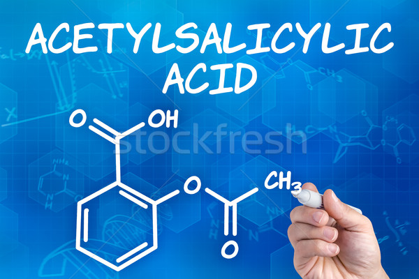 hand with pen drawing the chemical formula of acetylsalicylic acid Stock photo © Zerbor