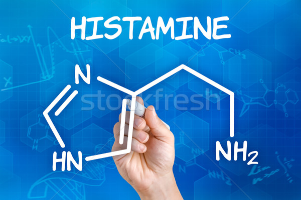 Hand with pen drawing the chemical formula of histamine Stock photo © Zerbor