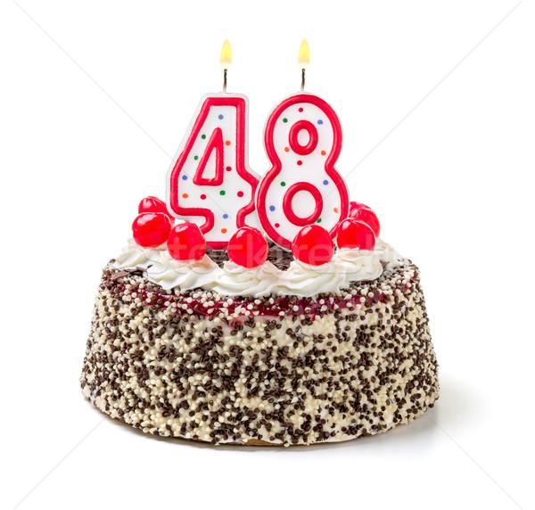 Birthday cake with burning candle number 48 Stock photo © Zerbor