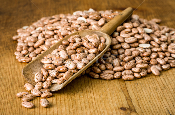 Wooden scoop with pinto beans Stock photo © Zerbor