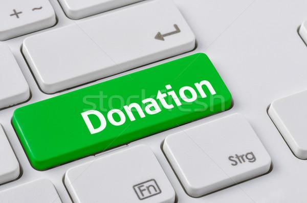 Tastiera verde pulsante donazione internet tecnologia Foto d'archivio © Zerbor