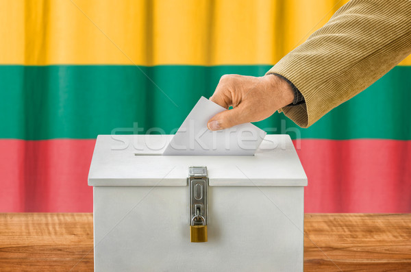 Man putting a ballot into a voting box - Lithuania Stock photo © Zerbor