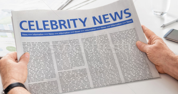 Man reading newspaper with the headline Celebrity News Stock photo © Zerbor