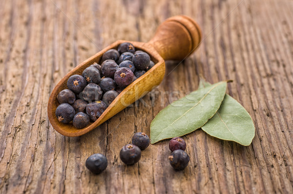 Spice scoop with juniper berries and bay leaves Stock photo © Zerbor