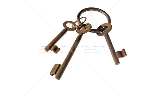 three antique rusty keys on ring Stock photo © Zerbor
