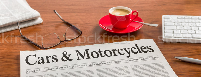A newspaper on a wooden desk - Cars and Motorcycles Stock photo © Zerbor