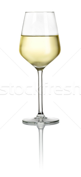 Filled white wine glass on a white background Stock photo © Zerbor
