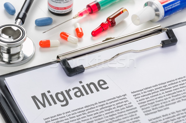 The diagnosis Migraine written on a clipboard Stock photo © Zerbor