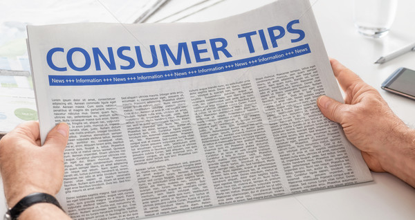Man reading newspaper with the headline Consumer Tips Stock photo © Zerbor