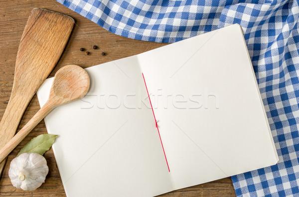 Kitap ahşap kaşık mavi masa örtüsü Stok fotoğraf © Zerbor