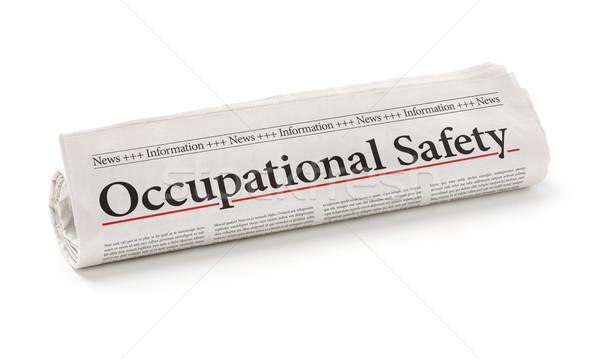 Rolled newspaper with the headline Occupational Safety Stock photo © Zerbor