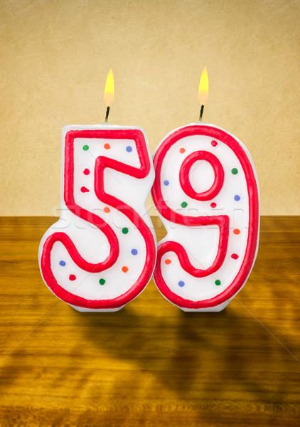 Brûlant bougies d'anniversaire nombre bois signe calendrier Photo stock © Zerbor