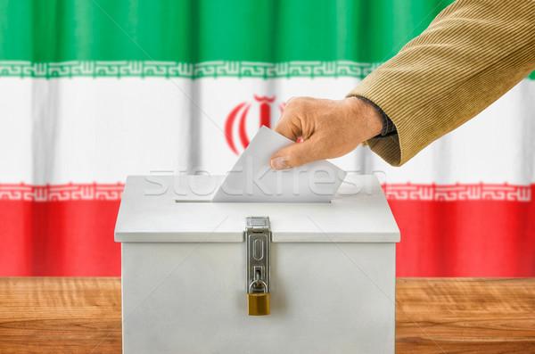 Férfi szavazócédula szavazás doboz Irán buli Stock fotó © Zerbor
