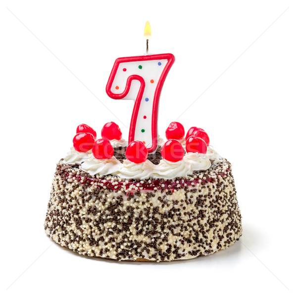 Birthday cake with burning candle number 7 Stock photo © Zerbor